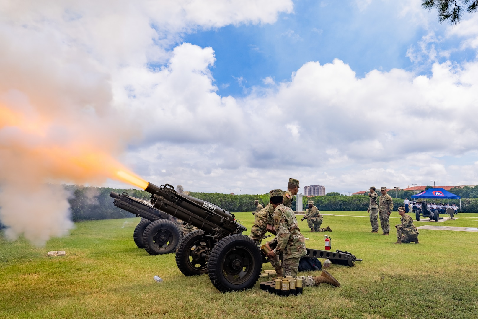 Fort Sam Houston Army Soldiers fire cannons during a Salute to the Nation ceremony, at the Joint Base San Antonio Main Flag Pole at MacArthur Parade Field at JBSA-Fort Sam Houston, Texas, July 4, 2021. The Soldiers fired 50 rounds as a salute to each of the 50 United States.