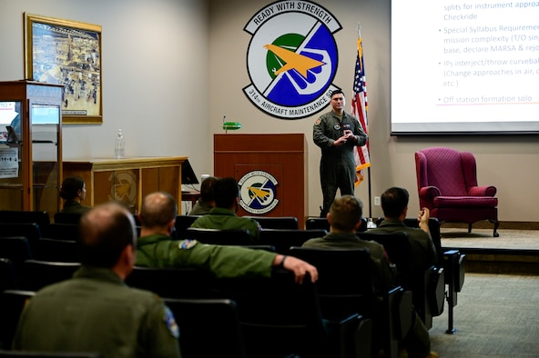 1st Lt. Donald King, 33rd Flight Training Squadron operations flight commander and first assignment instructor pilot (FAIP), answers questions from 314th Airlift Wing members