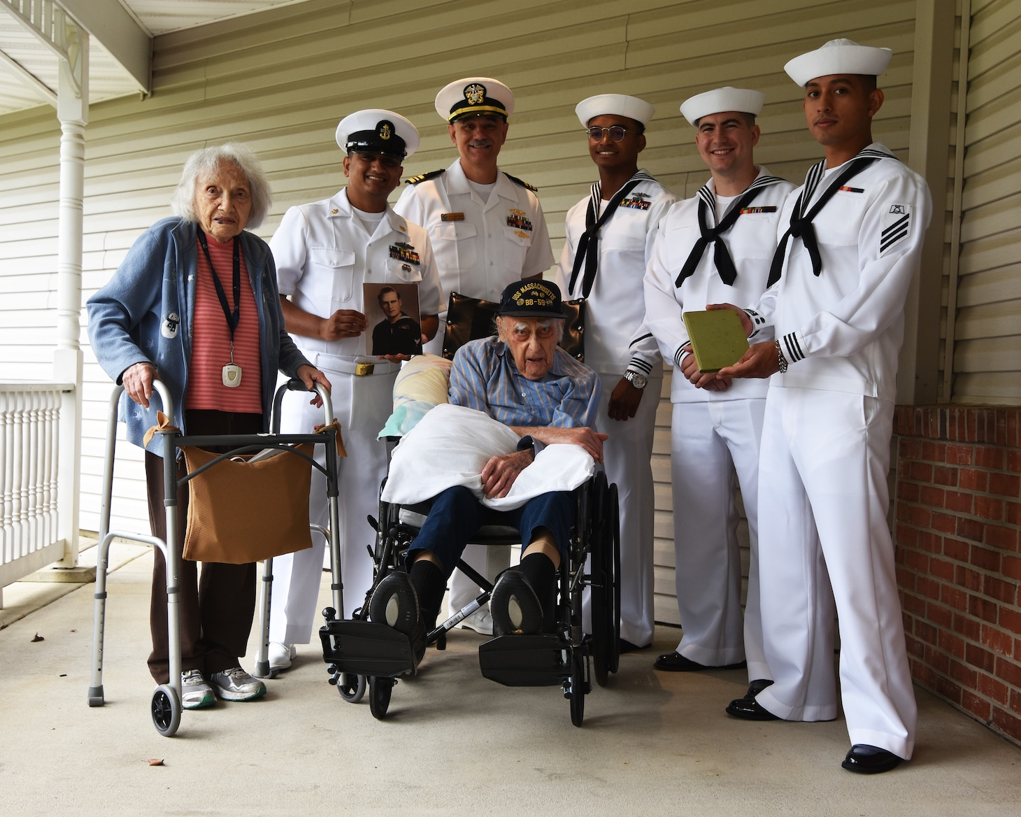 Sailors assigned to the future Virginia-class submarine PCU Massachusetts (SSN 798) stand World War II Veteran Baker 2nd Class Phil Dorf and his wife Etta during a visit July 2nd in Freehold New Jersey.