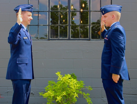 Lt. Col. Michael Knauf, left, administers the oath of office to newly-promoted 1st Lt. Ryan Blount during a promotion ceremony May 25, 2021, in Manchester, Tenn. (Courtesy photo)