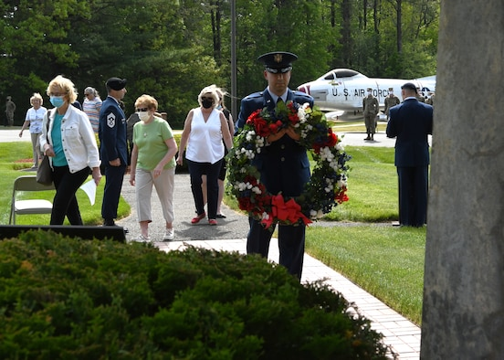 """104th Fighter Wing members gather to honor their brothers and sisters in arms fallen in flight during the annual F-100 Memorial Rededication Ceremony, May 21, 2021, at Barnes Air National Guard Base, Massachusetts. A firing squad made up of Airmen from across the wing fired a 21 gun salute in honor of our fallen. The ceremony honors 13 104FW Airmen for their service and sacrifice in duty to the state and country.  It is in memory of:  - 1st Lt. Edward W. Meacham, Monomoy Point, Massachusetts, Aug. 17, 1948 - Maj. Robert Anderstrom, Granby, Connecticut, May 7,1954  - 1st Lt. Richard Brown, Granville, Massachusetts, Oct. 19, 1954 - Tech. Sgt. Austin A. Cooper, Granville, Massachusetts, Oct. 19, 1954 - Capt. Frank A. Gibe, Westfield, Massachusetts, July 28, 1956  - Maj. Richard W. Mahoney, New Orleans, Louisiana, April 22, 1961  - 1st Lt. Joseph F. Crehore, Chalons, France March 21, 1962  - Capt. Hugh M. Lavalle, Upstate New York, Nov. 16, 1963 - Capt. John H. Paris, Westfield, Massachusetts, July 17, 1964  - Maj. James Romanowicz, Granby, Massachusetts, Feb. 1, 1965  - Capt. Leonard E. Bannish, Wilkes-Barre, Pennsylvania, May 30, 1968  - Maj. John S. Southrey, Wells, New York, Sept. 17, 1968  - Lt. Col. Morris """"Moose"""" Fontenot Jr., Deerfield Valley, Virginia, Aug. 27, 2014  (U.S. Air National Guard photo by Senior Airman Sara Kolinski)"""