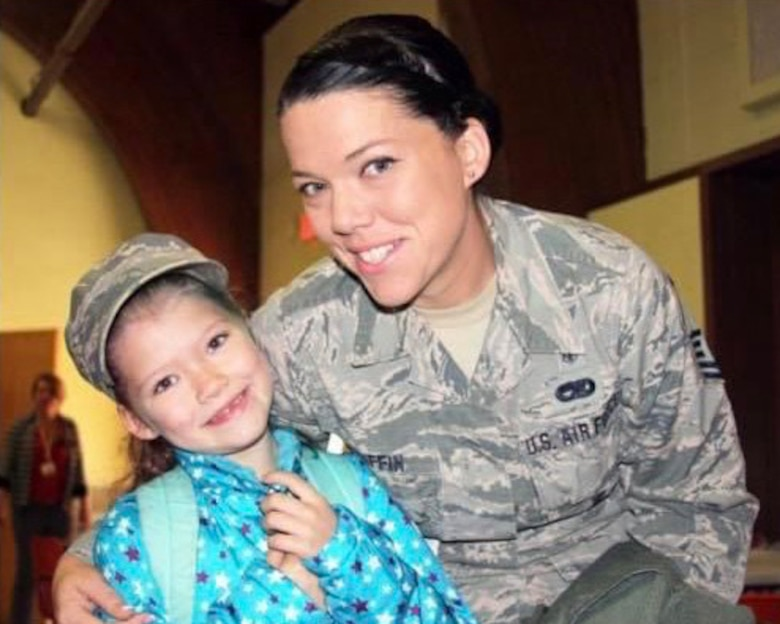 Master Sgt. Erica GriffinKing, 104th dental technician poses with her daughter for a photo during a Veteran's Day breakfast. GriffinKing is a mother to four children and has served in the Air National Guard for 19 years. (Courtesy photo)