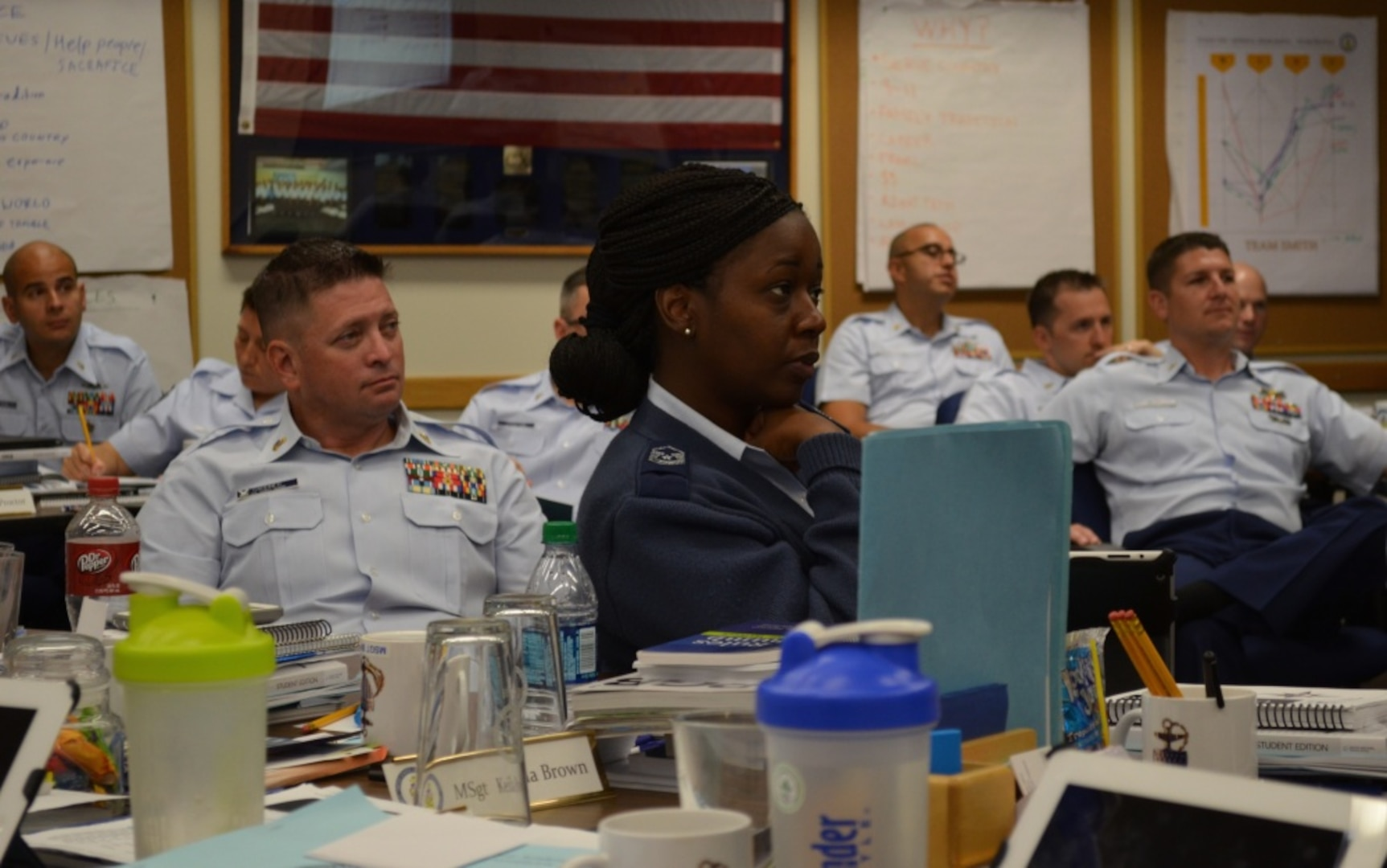 Air Force Master Sgt. Kelisha Brown and fellow Coast Guard senior enlisted leaders listen to leadership best practices as part of the Coast Guard Chief Petty Officers' Academy at Coast Guard Training Center Petaluma, Sept. 4, 2014. The monthlong course, which is open to a select few senior enlisted leaders from other military services, helps prepare new Coast Guard chiefs for the increased responsibility they take on as members of the Chief Petty Officer Corps. Instruction is provided in work-life, wellness, human resource management, oral and written communications, career management, human relations and military customs and courtesies.
