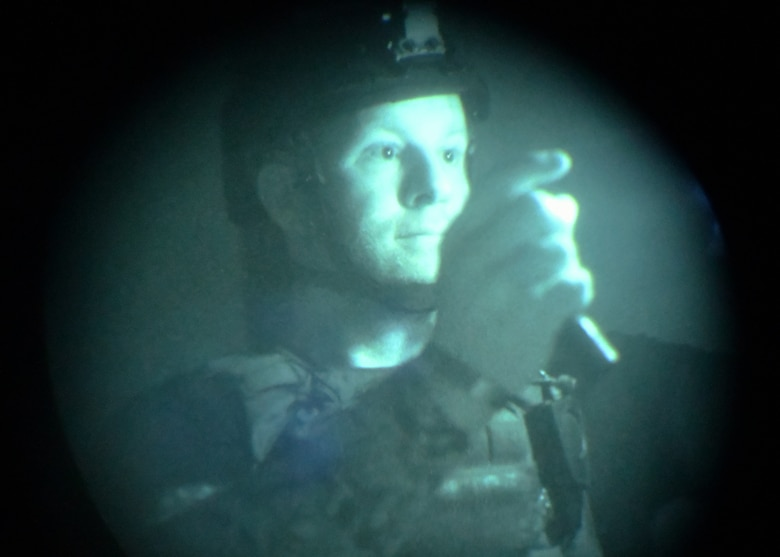 Adam Cavanaugh, New Jersey state police department bomb squad detective, advances through a no light/low light training scenario during Raven's Challenge Interoperability Exercise June 9, 2021, at Fort Devens Army Base, Devens, Massachusetts. The NJPD and Airmen from the 104th Fighter Wing spent a week at the exercise training together in various scenarios, promoting interoperability between the agencies in operational environments while promoting teamwork and innovation.  (U.S. Air National Guard photo by Senior Airman Sara Kolinski)