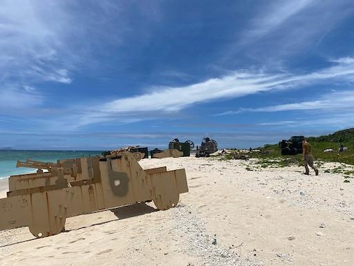 A stationary target sits on a beach