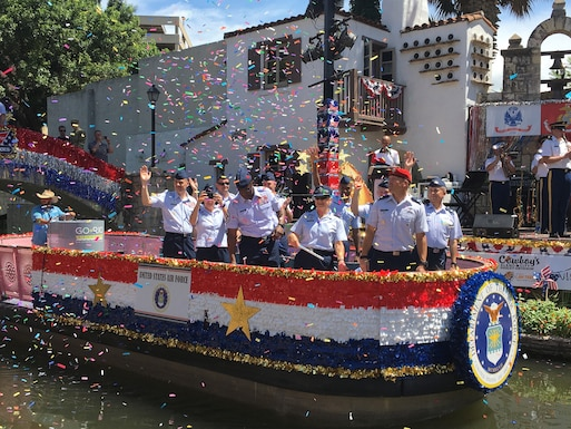 Senior Air Force leaders from Joint Base San Antonio, Texas, participate in the annual Armed Forces River Parade on the San Antonio River Walk, July 3, 2021. Col. Richard Erredge, 960th Cyberspace Wing commander, and Chief Master Sgt. Christopher Howard, 960th Cyberspace Operations Group superintendent, represented the 960th CW Gladiators during the event. (Courtesy photo)