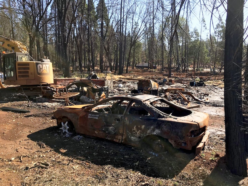 A scorched car frame that survived the Camp Fire in Paradise, California. The frame, among other debris, was cleared before disaster response crews could begin rebuilding the housing lots (U.S. Army Photo by James Frost).