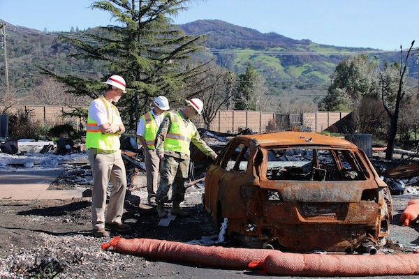 Corps personnel assessing scorched infrastructure after the October 2017 Northern California Wildfires, which covered more than 245,000 acres of land. In coordination with FEMA, corps volunteers deployed to Sonoma to support the Consolidated Debris Removal Program which removed more than 2.2 million tons of ash from the affected areas (U.S. Army photo by Carol Vernon).