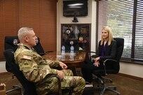 Maj. Gen. Michael Turley, adjutant general, Utah National Guard, speaks with Elizabeth Smart May 24, 2021, at Draper, Utah.