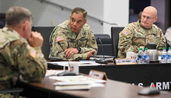 Gen. Michael X. Garrett, commanding general of U.S. Army Forces Command, and Gen. Ed Daly, commanding general of Army Materiel Command, participate in a briefing on the full range of AMC's support to FORSCOM units and people, July 1 at AMC headquarters at Redstone Arsenal, Alabama. The two leaders, joined by key AMC staff and commanders from leaders from AMC's 10 major subordinate commands, discussed how the materiel and installation enterprise is improving equipment on hand rates, facilitating divestiture and turn in, modernizing Army Prepositioned Stocks, enabling strategic power projection of units and improving quality of life across FORSCOM installations.