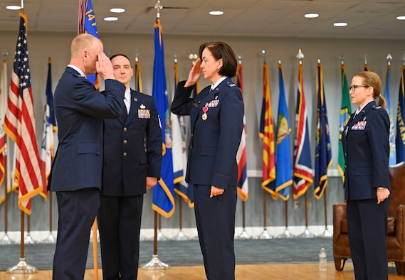 U.S. Air Force Col. Seth Graham, 14th Flying Training Wing commander, returns a salute to Col. Betty Venth, out-going 14th Medical Group commander, after presenting her with the Legion of Merit, during a Change of Command ceremony, July 6, 2021, on Columbus Air Force Base, Miss. The Legion of Merit is awarded to service members in key positions or responsibility for exceptionally meritorious conduct in the performance of outstanding serviced and achievements. (U.S. Air Force photo by Airman 1st Class Jessica Haynie)