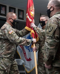 Col. William Wagner (center) accepts the guidon for the 124th Regiment (Regional Training Institute) from Brig. Gen. James Pabis (left) during the 124th RTI's change-of-command ceremony March 6, 2021, at Camp Johnson, Vermont. The 124th RTI is home to the Army Mountain Warfare School, Information Operations Battalion, Officer Candidate Scchool, and the Basic Leaders Course. Also pictured is Command Sgt. Maj. John Digby III (right), the 124th RTI command sergeant major. (U.S. Army National Guard photo by Don Branum)