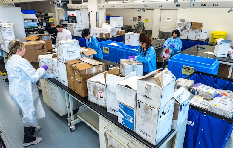 Laboratory technicians unpack and log in blood serum, fecal, urine or respiratory samples which arrive from U.S. Air Force hospitals and clinics around the world, as well as some other Department of Defense facilities Jan. 30, 2018. The Epidemiology Laboratory Service, also known as the 'Epi Lab,' at the 711th Human Performance Wing's United States Air Force School of Aerospace Medicine and Public Health at Wright Patterson AFB, Ohio, receives 100-150 boxes a day, six days a week. The lab, which tests between 5,000 and 8,000 samples daily, is a Department of Defense reference laboratory offering clinical diagnostic, public health, and force health screening and testing. (U.S. Air Force photo by J.M. Eddins Jr.)