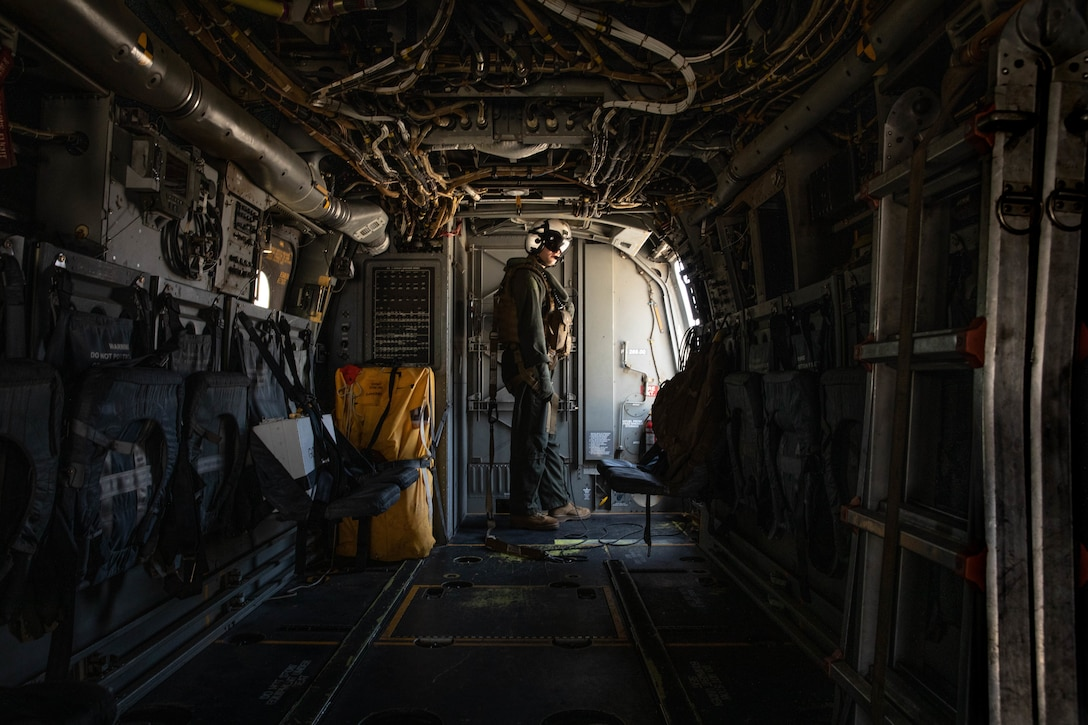 U.S. Marine Corps Lance Cpl. Louis J. Donatucci III, a tiltrotor crew chief with Marine Medium Tiltrotor Squadron (VMM) 166, Marine Aircraft Group 16, 3rd Marine Aircraft Wing, inspects the aircraft in preparation for takeoff before the final flight of the squadron at Marine Corps Air Station Miramar, California, June 30, 2021. VMM-166 conducted its final flight in preparation for deactivation in accordance with Force Design 2030, which is a plan that will ensure the Marine Corps is prepared to stand as the nation's naval expeditionary force-in-readiness. (U.S. Marine Corps photo by Lance Cpl. Quince Bisard)