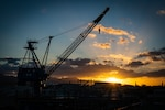 Pearl Harbor, Hawaii - Pearl Harbor Naval Shipyard & IMF, (February 11, 2021) Sunrise over the Ko`olau Mountains with portal crane P-76 in the foreground.