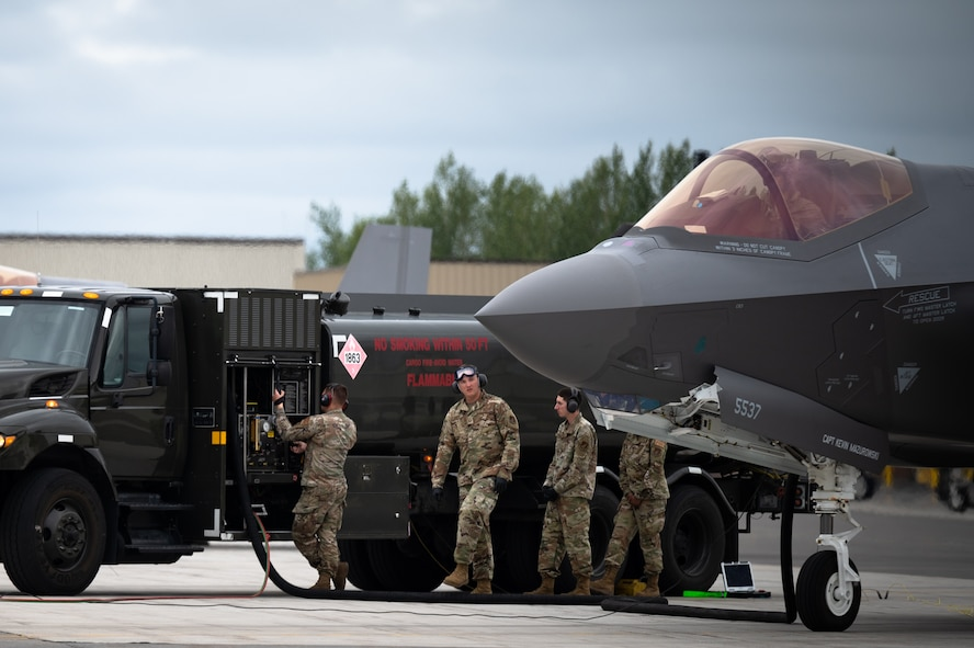 U.S. Airmen assigned to  the 354th Fighter Wing conduct a hot pit refueling on an F-35A Lightning II aircraft assigned to the 355th Fighter Squadron on Eielson Air Force Base, Alaska, July 7, 2021.