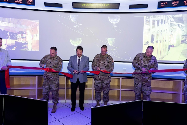 The Space and Missile Systems Center hosted a ribbon-cutting ceremony to unveil the Rendezvous and Proximity (REPR) Satellite Operations Center at Kirtland Air Force Base, N.M., Jul. 7, 2021. From left to right, pictured in the ribbon-cutting are Lt Col Brendan J. Hochstein, Development Corps Material Leader, Mr. Dan Crouch, Senior Materiel Lead of SMC's Innovation and Prototyping Directorate, Prototype Operations Division, Col. Timothy A. Sejba, Space Development program executive officer, and Col. Joseph J. Roth, Director of SMC's Innovation and Prototyping Directorate. The center will provide necessary infrastructure for U.S. Space Force and mission partners to prototype and experiment on orbit future space architecture. (Courtesy photo)