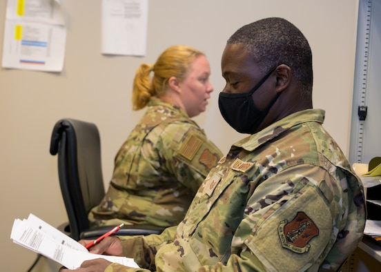 U.S. Air Force Tech. Sgt. Brenda Franklin, left, a public health specialist with the 116th Medical Group, conducts a medical examination with Tech. Sgt. Dewayne Bembry, an aerospace propulsion craftsman with the 116 Maintenance Squadron, after he returned from a COVID-19 vaccination mission, Robins Air Force Base, Georgia, July 1, 2021. Airmen and Soldiers from the Georgia National Guard vaccinated more than 170,000 people.