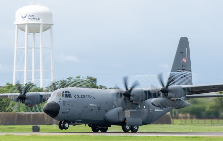 """A WC-130J Super Hercules aircraft assigned to the 53rd Weather Reconnaissance Squadron at Keesler Air Force Base, Miss., takes off for a flight into Tropical Storm Elsa July 6, 2021. The 53rd WRS """"Hurricane Hunters"""" are an Air Force Reserve unit assigned to the 403rd Wing and are the only unit in the Department of Defense that flies weather reconnaissance missions .(U.S. Air Force by Staff Sgt. Kristen Pittman)"""