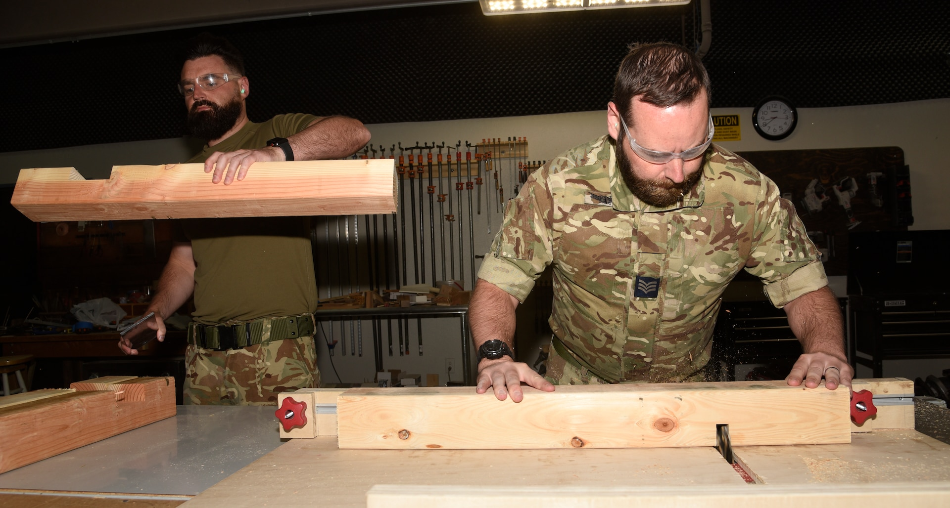 United Kingdom Royal Air Force prepare pieces of wood