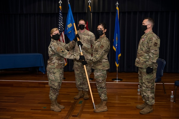 U.S. Air Force Col. Betsy Ross, 52nd Mission Support Group commander (left), passes the 52nd Force Support Squadron guidon to U.S. Air Force Maj. Ingrid Muniz, incoming 52nd FSS commander, at the squadron's change of command ceremony July 6, 2021, on Spangdahlem Air Base, Germany. In addition to providing services to service members, civilian employees and their families at Spangdahlem AB, the 52nd FSS also supports 16 geographically separated units by providing administrative, personnel, contingency response and quality of life support. (U.S. Air Force photo by Senior Airman Ali Stewart)