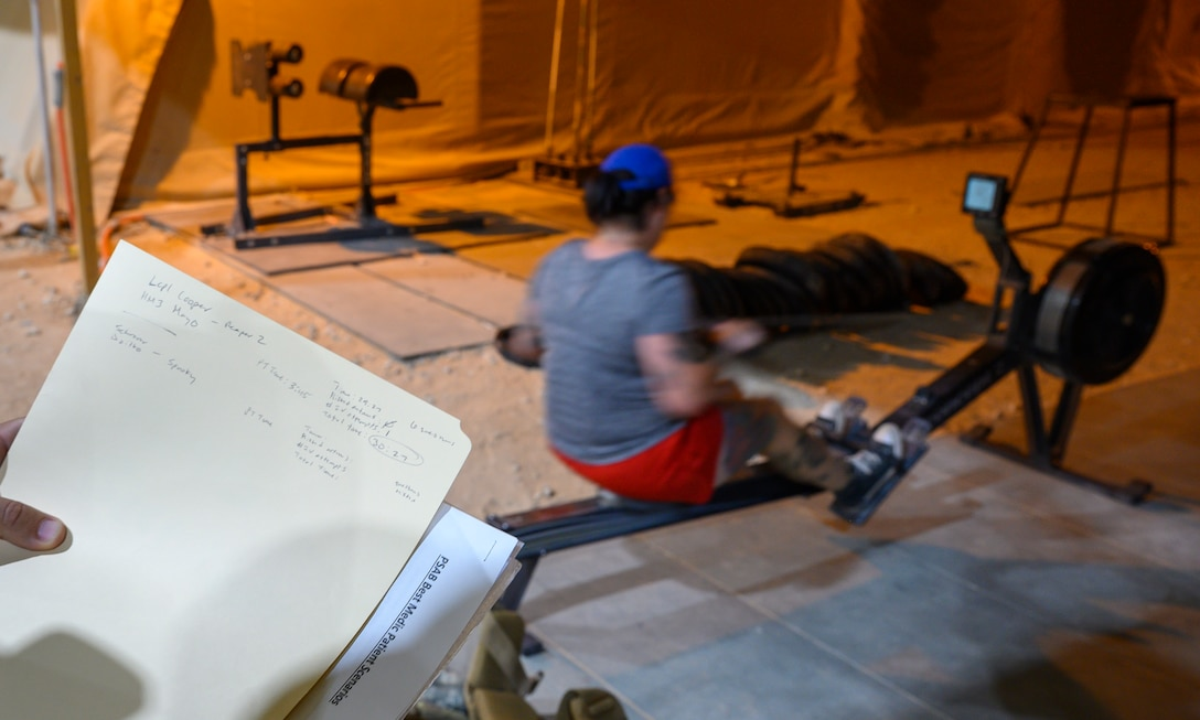U.S. Air Force Staff Sgt. Kelly Dzitko, 378th Expeditionary Medical Squadron respiratory therapist, accomplishes the row portion of the first best medic competition at Prince Sultan Air Base, June 21, 2021. The competition was a culmination of the past 11 weeks of combat medicine training, testing their ability to provide care in unexpected situations.  (U.S. Air Force photo by Senior Airman Samuel Earick)