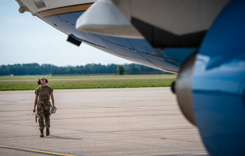 Senior Airman Janice Williams, 932nd Maintenance Squadron crew chief, performs a pre-flight inspection and launches the aircraft June 30, 2021, Scott Air Force Base, Illinois. (U.S. Air Force photo by Christopher Parr)