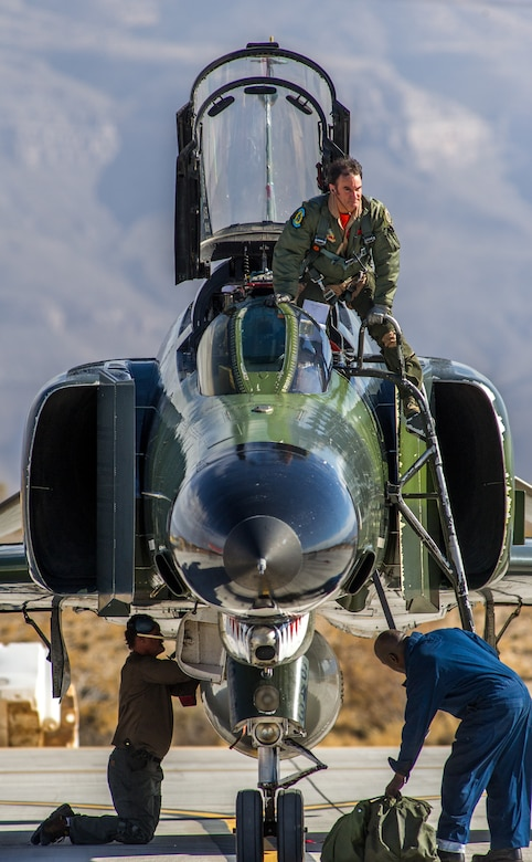 """Civilian QF-4E Pilot/Controller Lt. Col. (Ret) Jim """"WAM"""" Harkins, exits his McDonnell Douglas F-4 Phantom II, after a rehearsal for the final military flight and retirement ceremony for the storied aircraft at Holloman AFB, N.M., Dec. 16, 2016. The final variant of the Phantom II was the QF-4 unmanned aerial targets flown by the 82nd Aerial Target Squadron Detachment 1 at Holloman AFB. The ceremonial flight was Harkins last in a cockpit for DoD; he will now be a ground controller for the QF-4's replacement, the QF-16. The F-4 Phantom II entered the U.S. Air Force inventory in 1963 and was the primary multi-role aircraft in the USAF throughout the 1960s and 1970s. The F-4 flew bombing, combat air patrol, fighter escort, reconnaissance and the famous Wild Weasel anti-aircraft missile suppression missions.  (U.S. Air Force photo by J.M. Eddins Jr.)"""