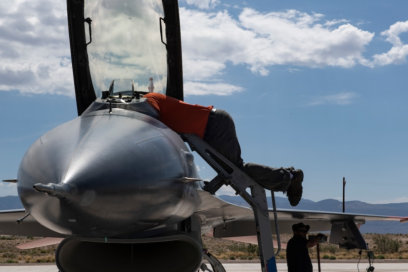 Civilian Maintainers prepare QF-16s for a dress rehearsal flight at Holloman Air Force Base, New Mexico before the planned shoot down of a QF-16 over the White Sands Missile test range. (U.S. Air Force photo by Tech. Sgt. Perry Aston)