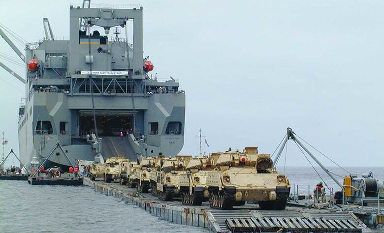 A Strategic Sealift Ship offloads Bradley Fighting Vehicles. (Military Sealift Command photo)