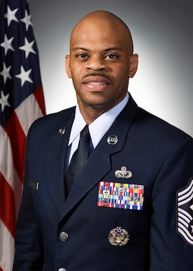 Official biography photos for Chief Master Sgt. Travon W. Dennis.