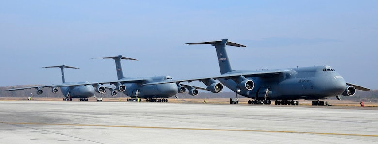 Three C-5 Galaxy aircraft sit lined up on the flightline at Westover Air Reserve Base, Mass., March 19, 2012. The 439th Airlift Wing, a unit of the Air Force Reserve Command, operates 16 C-5A and B model aircraft. (U.S. Air Force photo/Senior Airman Kelly Galloway)