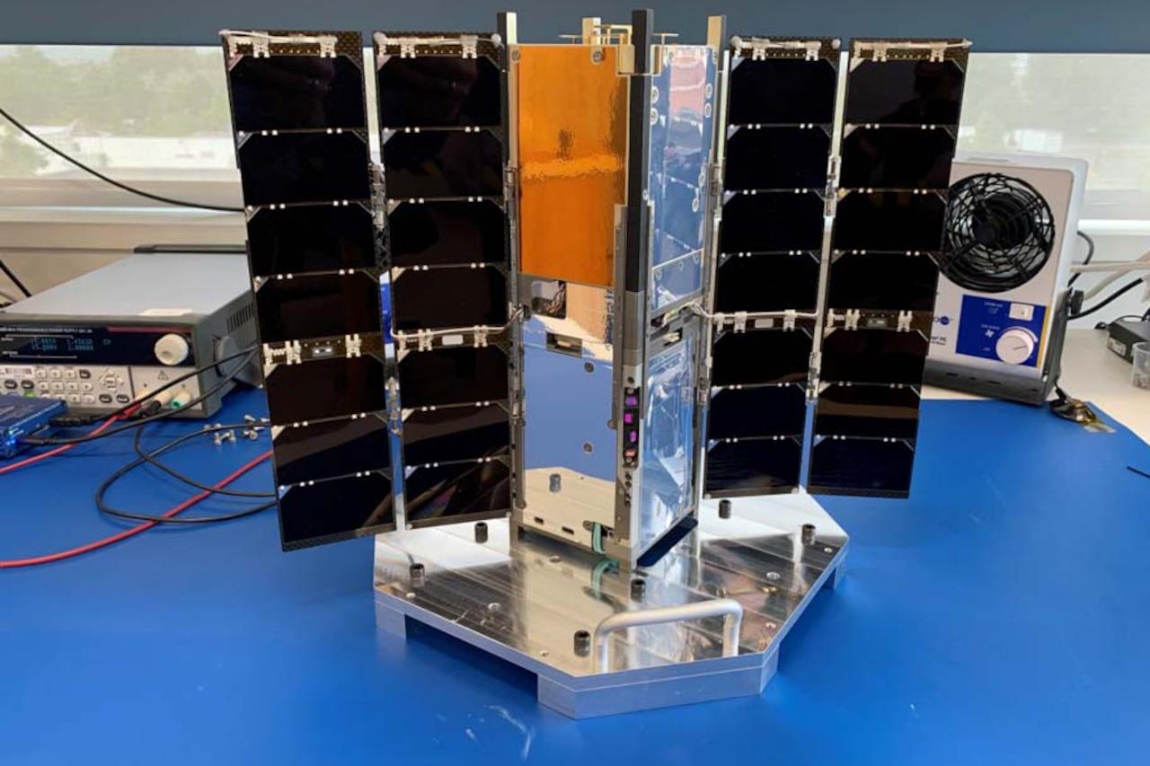 A photo shows a satellite.