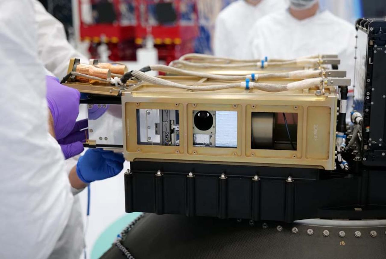 Engineers handle device