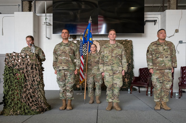 From left, Col. Frank Reyes, 341st Security Forces Group commander; Maj. Brian Gilliam, 341st MSOS outgoing commander; and Lt. Col. Min Lee, 341st MSOS incoming commander, stand at attention while 1st Lt. Leslie Fallert, 341st MSOS logistics and resources officer and ceremony emcee, reads the orders during a change of command ceremony July 7, 2021, at Malmstrom Air Force Base, Mont.