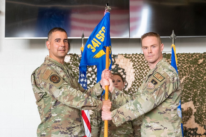 Maj. Brian Gilliam, 341st Missile Security Operations Squadron outgoing commander, relinquishes command to Col. Frank Reyes, 341st Security Forces Group commander, during a change of command ceremony July 7, 2021, at Malmstrom Air Force Base, Mont.