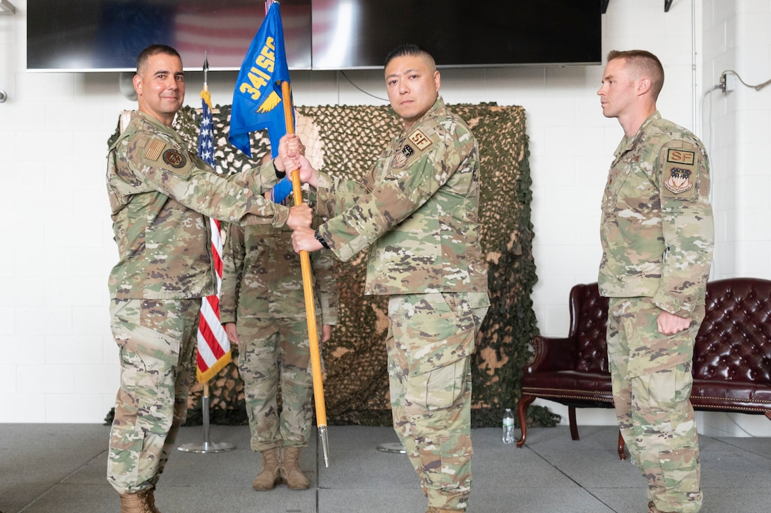 Lt. Col. Min Lee, 341st Missile Security Operations Squadron incoming commander, assumes command from Col. Frank Reyes, 341st Security Forces Group commander during a change of command ceremony July 7, 2021, at Malmstrom Air Force Base, Mont.