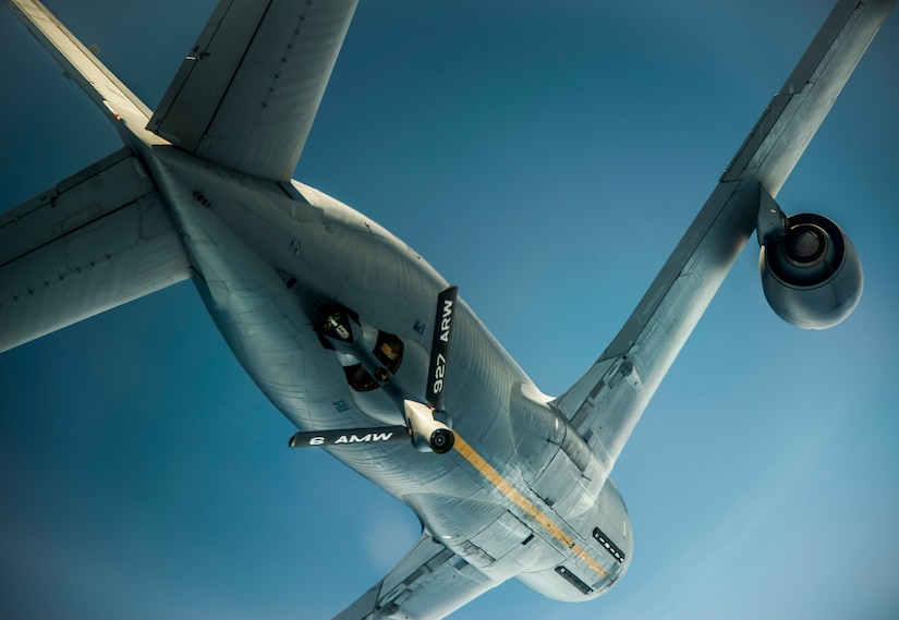 A 927th Air Refueling Wing KC-135 Stratotanker soars overhead after refueling a C-17 Globemaster III July 1, 2014. The C-17 relies on aerial refueling to complete long-distance missions into and out of the theater of operations. (U.S. Air Force photo/Airman 1st Class Clayton Cupit)