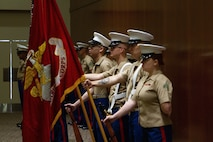 The Recruiting Station Raleigh color guard stands at parade rest during the Recruiting Station Raleigh Change of Command Ceremony held at the McKimmon Center in Raleigh, North Carolina, June 28, 2021. The outgoing Commanding Officer Maj. Dennis Dunbar relinquished command to Maj. Chad Kelling.