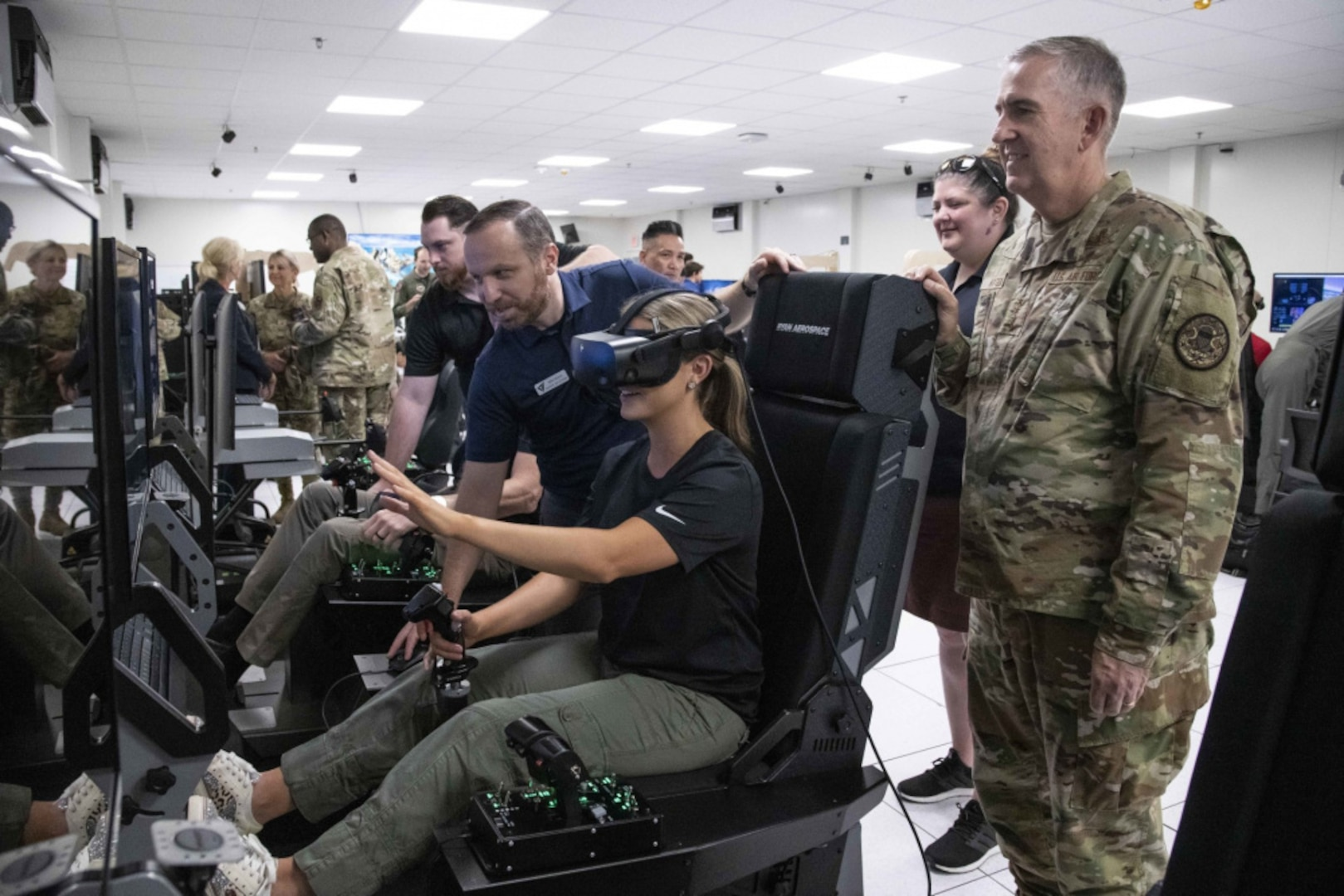 Miss America Camille Schrier uses a virtual reality flight simulator at Joint Base San Antonio-Randolph.