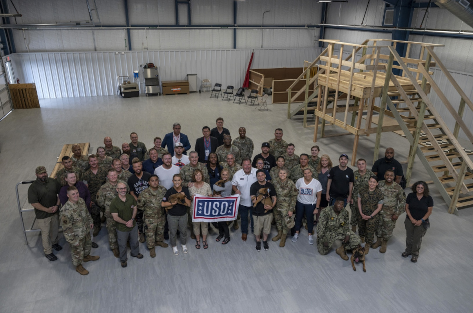 A group photo of military and civilian members during the USO Tour at Joint Base San Antonio.