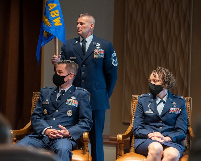 Cols. Paul Burger and Sirena Morris (seated) prepare for a leadership transition during the 88th Mission Support Group's change-of-command ceremony July 1 in the Wright-Patterson Club. Morris took command of the group from Burger. (U.S. Air Force photo by R.J. Oriez)