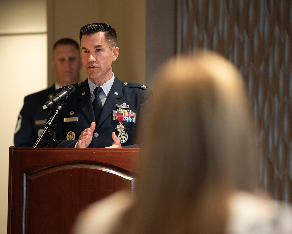 Col. Paul Burger says goodbye to the 88th Mission Support Group during the unit's change-of-command ceremony July 1 in the Wright-Patterson Club. Burger relinquished command to Col. Sirena Morris. (U.S. Air Force photo by R.J. Oriez)