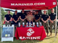 U.S. Marines from Recruiting Station Frederick, set up a table display at the Darn Good Country Weekend concert in Centreville, Virginia July 3, 2021. The Marines attended this event to speak with young men and women about enlistment in the U.S. Marine Corps. (U.S. Marine Corps photo by Sgt. Ryan Sammet)