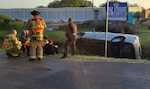 Marine rescues children from overturned vehicle