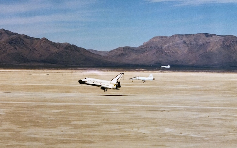 Two T-38 chase planes follow Space Shuttle Columbia as it lands at Northrop Strip in White Sands, New Mexico, ending its mission STS-3. (Photo NASA)
