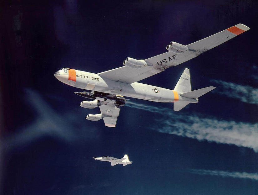 X-15 in flight attached to B-52 mother ship, with T-38 chase plane in 1961. (Photo NASA)