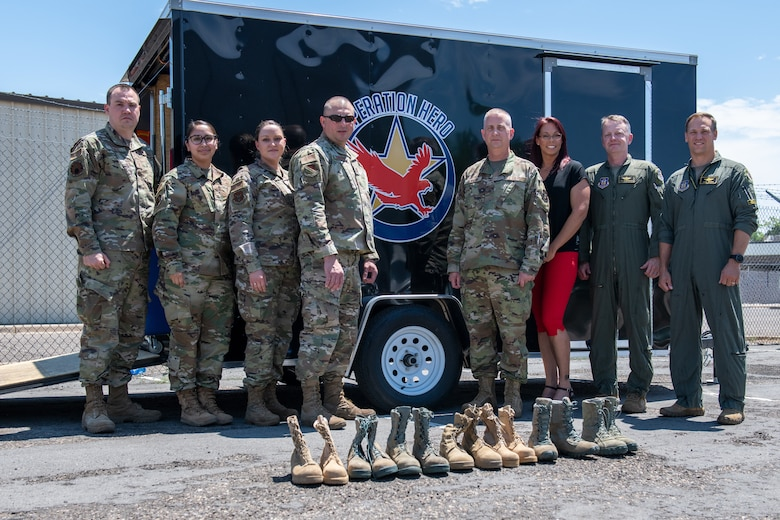 Col. Brett Newman, 419th Maintenance Group commander, poses with members from the 419th and 388th Fighter Wings in front of boots collected for the Operation Hero Boot Drive at Hill Air Force Base, Utah on July 7, 2021.