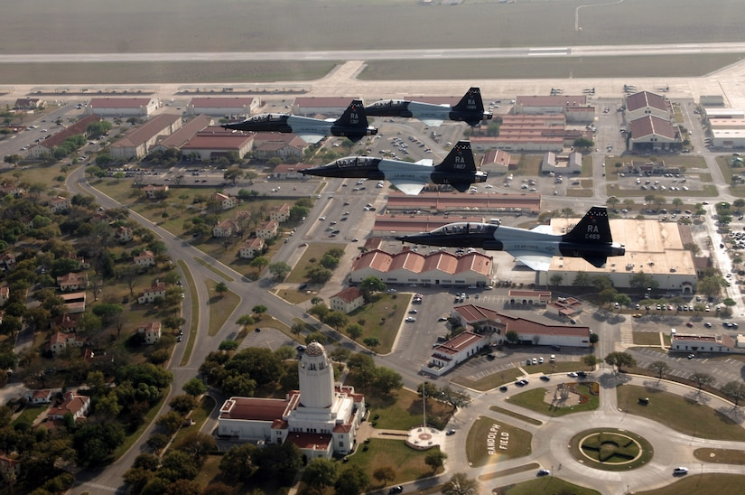 Four T-38 Talons fly over Randolph Air Force Base, Texas. The T-38 completed its first flight 50 years ago April 10, 1959. In five decades of service, more than 75,000 pilots have flown in a T-38 while earning their wings. (U.S. Air Force photo by Master Sgt. Scott Reed)