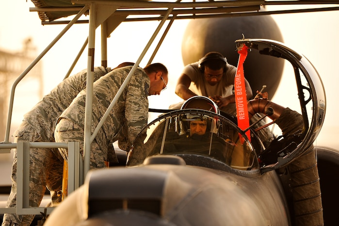Members of the 99th Expeditionary Reconnaissance Squadron integrate Lt. Col. Jeff Klosky into his U-2 Dragon Lady April 19, 2014, at an undisclosed location in Southwest Asia. The flight marked Klosky's  2,500th hour of flight in the U-2 Dragon Lady. (U.S. Air Force photo byTech. Sgt. Russ Scalf)